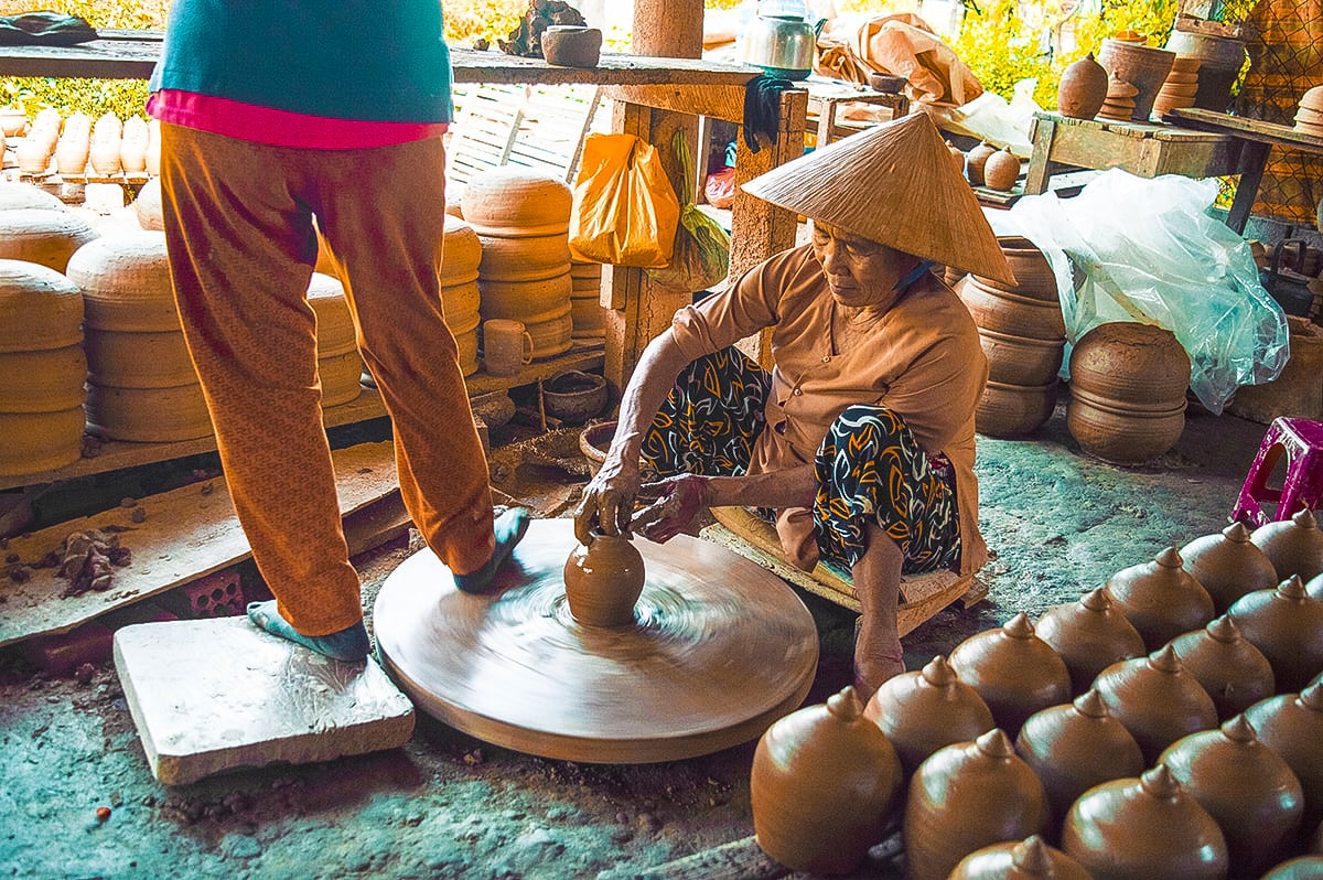 spinning pots at thanh ha pottery village hoi an vietnam