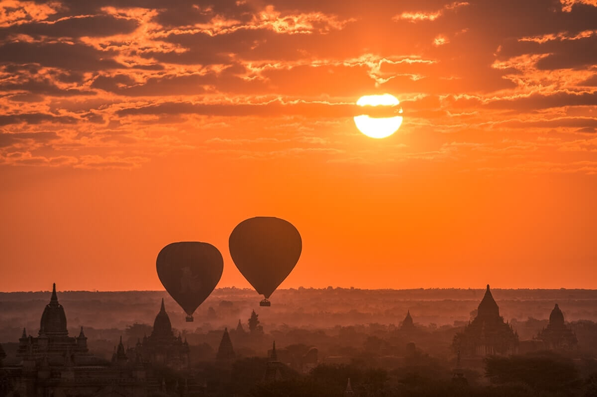 zoom shot of the temples in bagan with hot air balloons