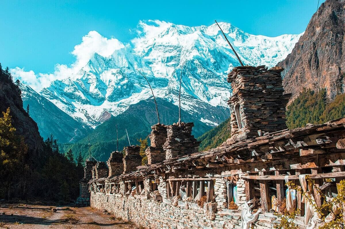 prayer wheel and mountain upper pisang to ngawal on the annapurna circuit nepal