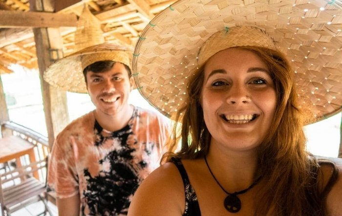 selfie in rice hats tasha amy while backpacking laos on a budget