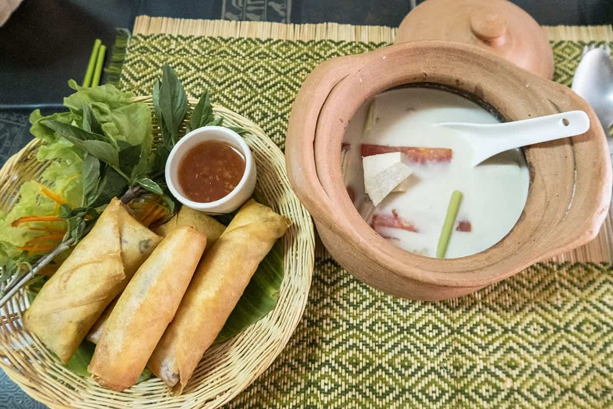 coconut tofu soup with spring rolls in the vegetarian cooking class in chiang mai