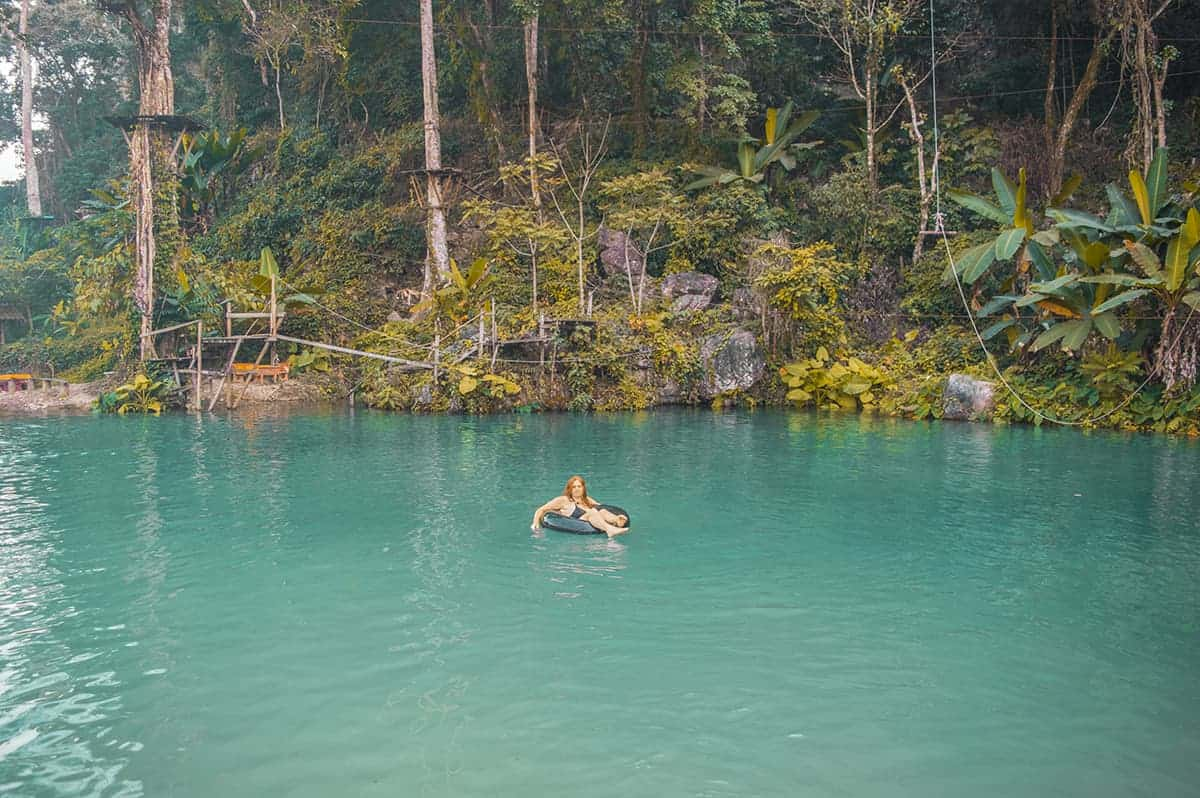 swimming on a tube at blue lagoon 3 in vang vieng