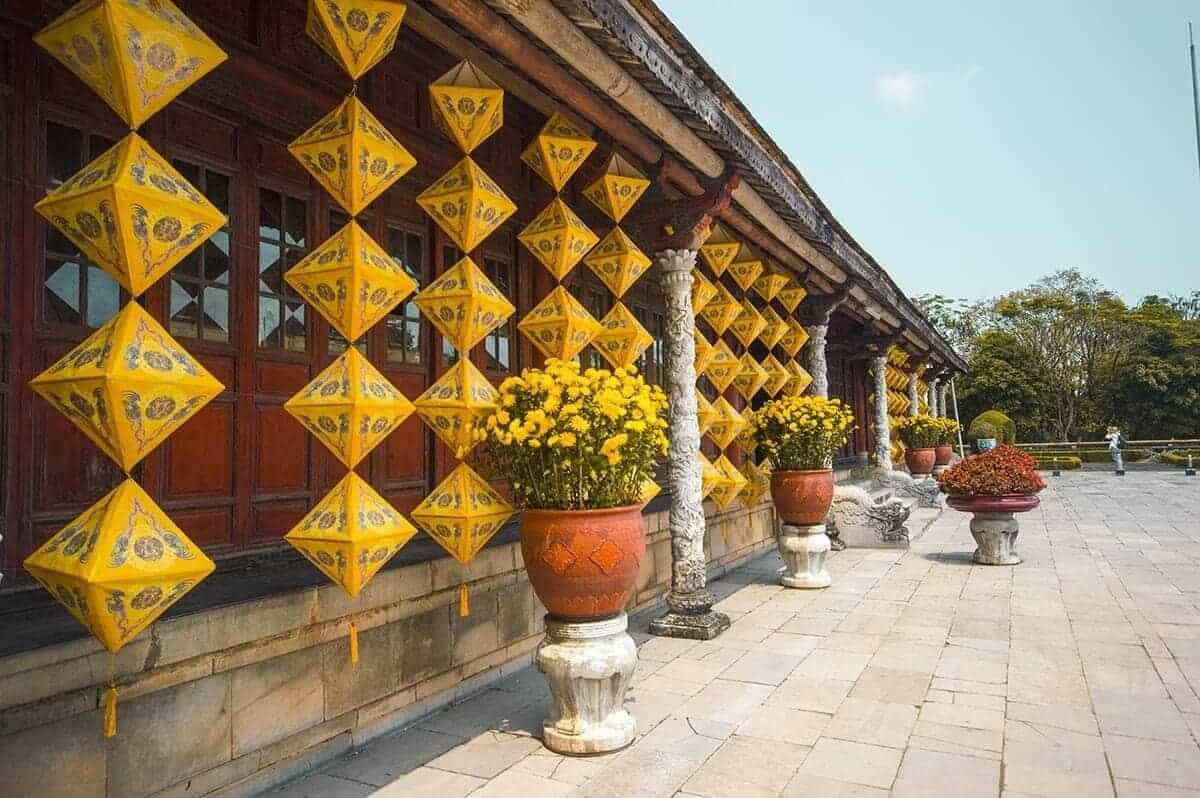 beautiful decorations on the buildings inside the imperial city backpacking hue on the 2 days in hue itinerary